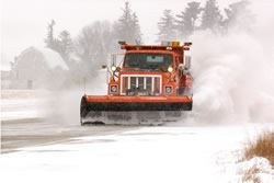 Snowplow truck removing snow