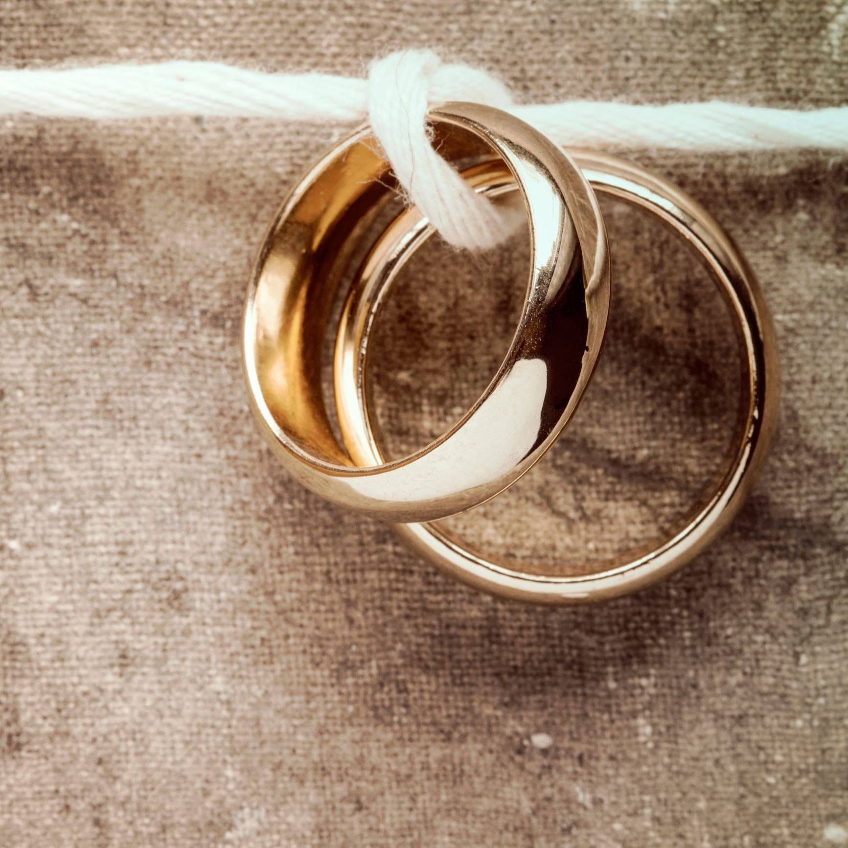 Two wedding rings on string.