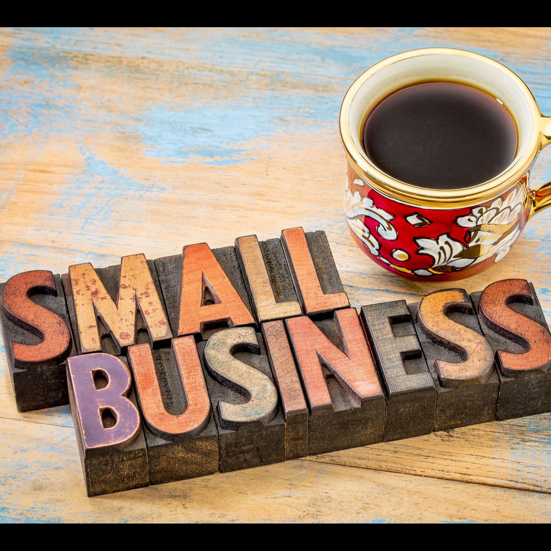 """Small Business"" written in block letters next to a coffee cup."