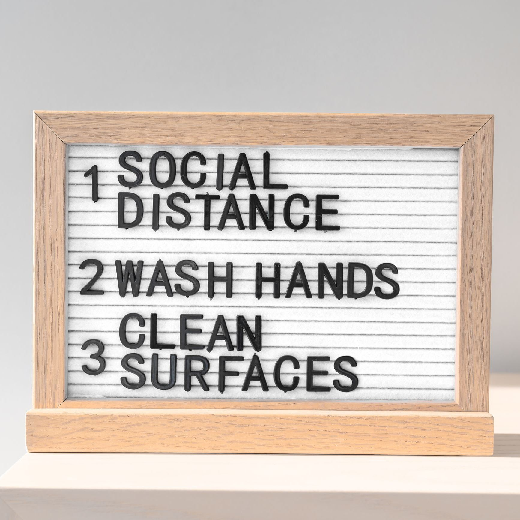 """Social distance, wash hands, clean surfaces,"" sign."