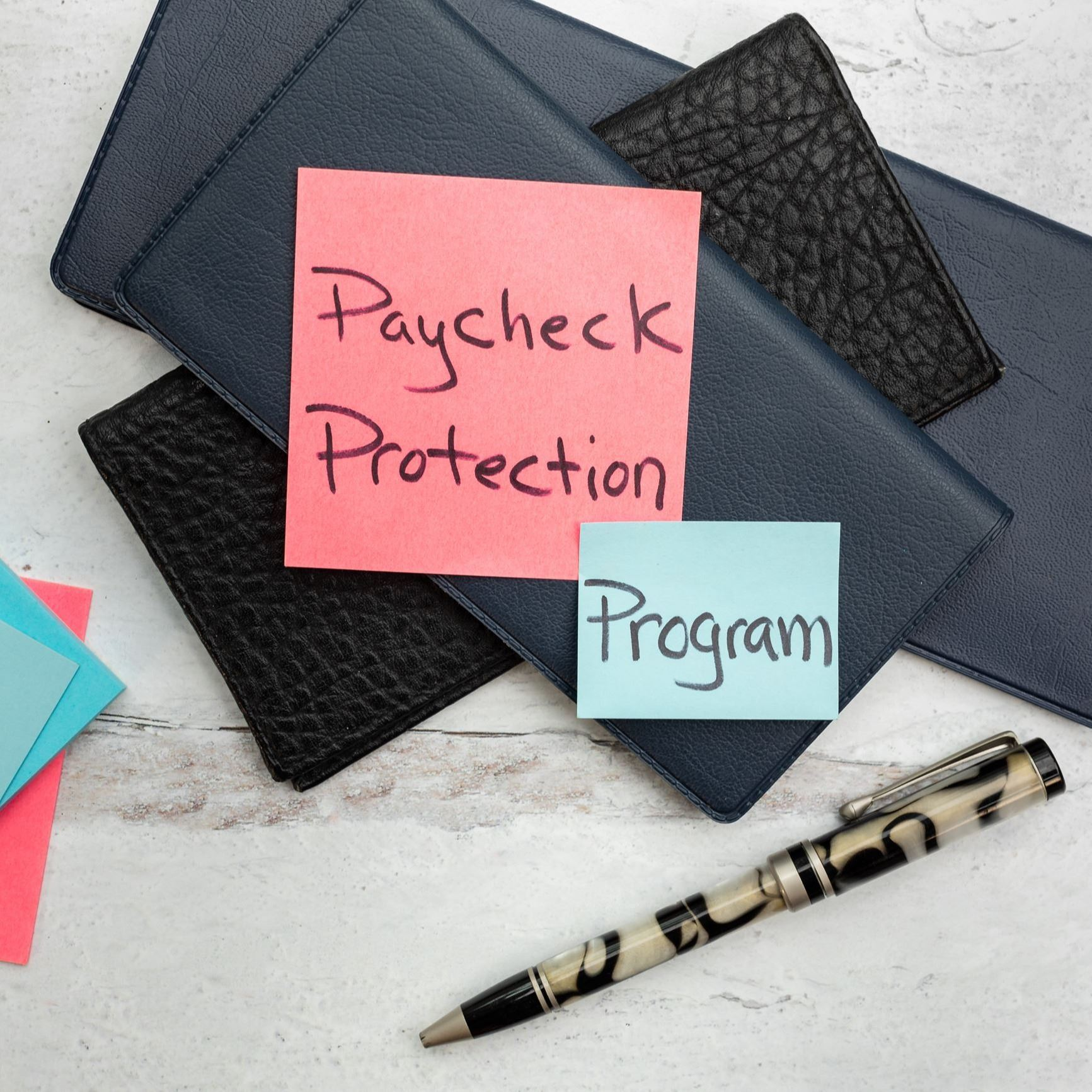 Paycheck Protection Program written on sticky notes.