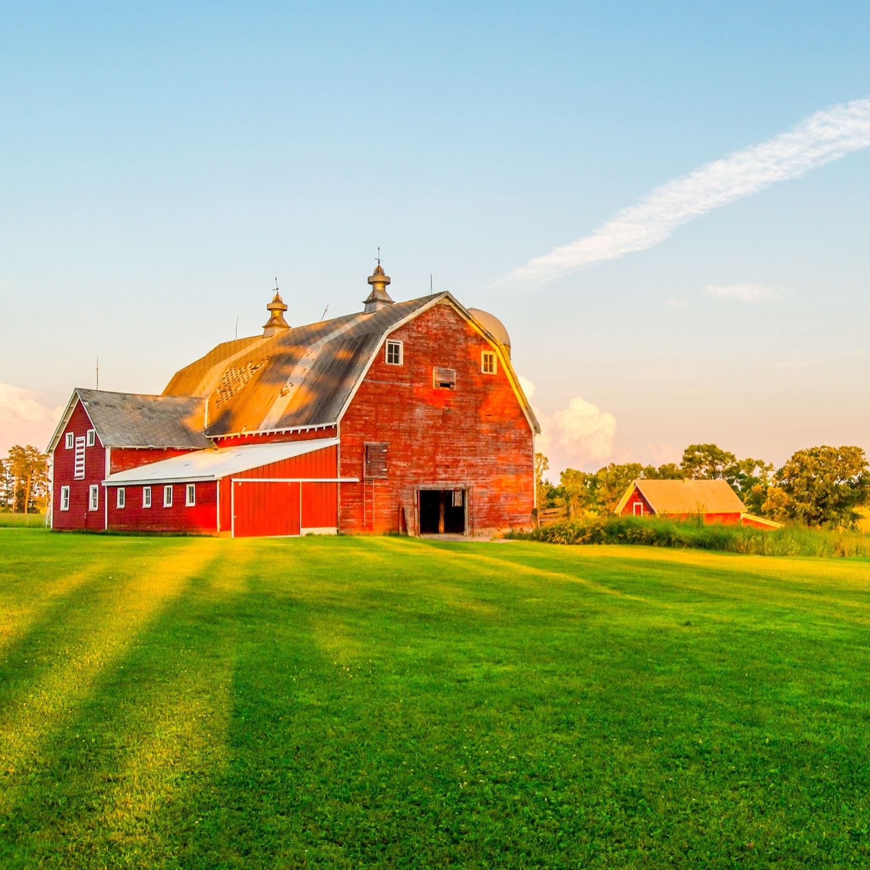 Red barn near large field.